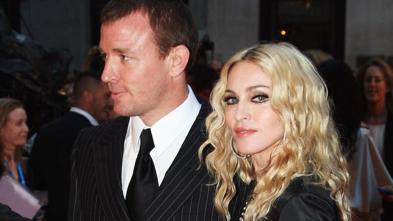Illustration for article titled Madonna Sources Say Guy Ritchie Is Turning Son Rocco Against Her