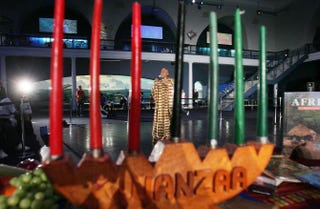 Camille Yarborough sings African music in view of a traditional kinara during a news preview of a Kwanzaa festival held at New York's American Museum of Natural History on Dec. 22, 2004.Mario Tama/Getty Images