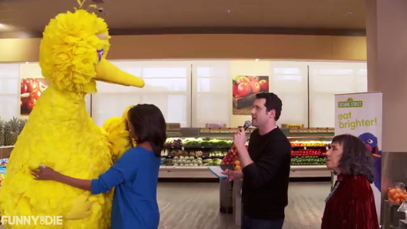 Illustration for article titled Screaming Billy Eichner Makes Michelle Obama Slow Dance With Big Bird