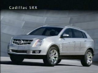 Illustration for article titled Rick Wagoner Unwraps First Shots Of Chevy Cruze, Cadillac SRX