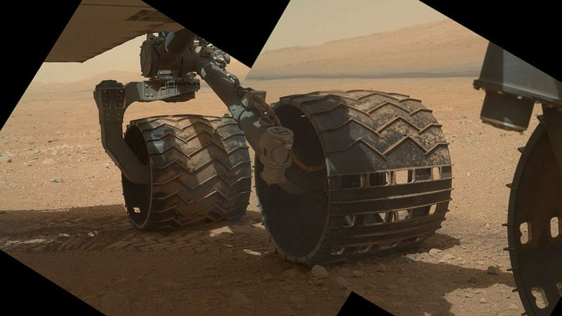 Illustration for article titled This shot of Curiosity's wheels makes us feel like we're right there