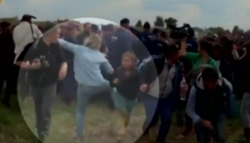 Illustration for article titled Hungarian Camerawoman Fired for Kicking and Tripping Migrants Running from Police