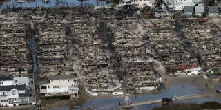 Remains of burned houses in Queens, N.Y., after Hurricane Sandy (Mario Tama/Getty Images)