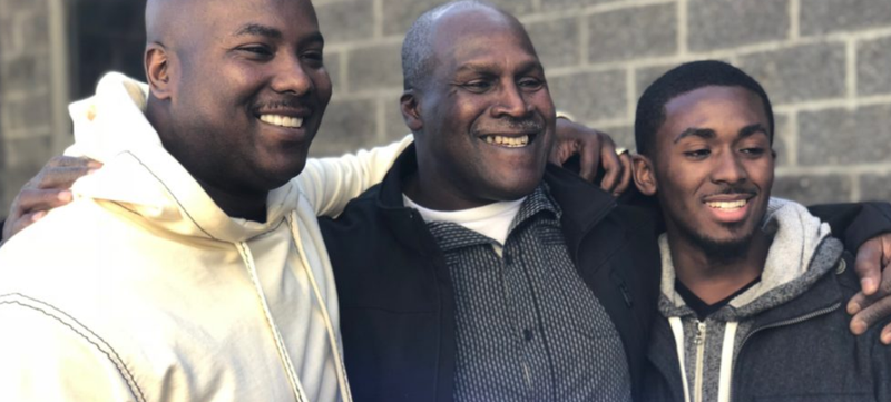 Malcolm Alexander (center) with his son and grandson—also named Malcolm—on the day he was exonerated, Jan. 30, 2018 (the Innocence Project)