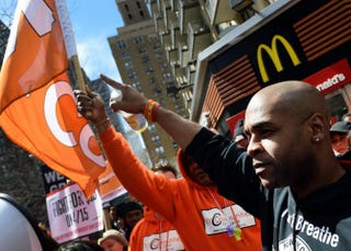 """Protesters gather outside a McDonald's restaurant in New York April 15, 2015, to rally as part of the """"Fight for $15"""" minimum wage movement.DON EMMERT/AFP/Getty Images"""