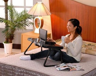 Illustration for article titled Laptop Bed Desk Comes With Built-in Fans, Speakers