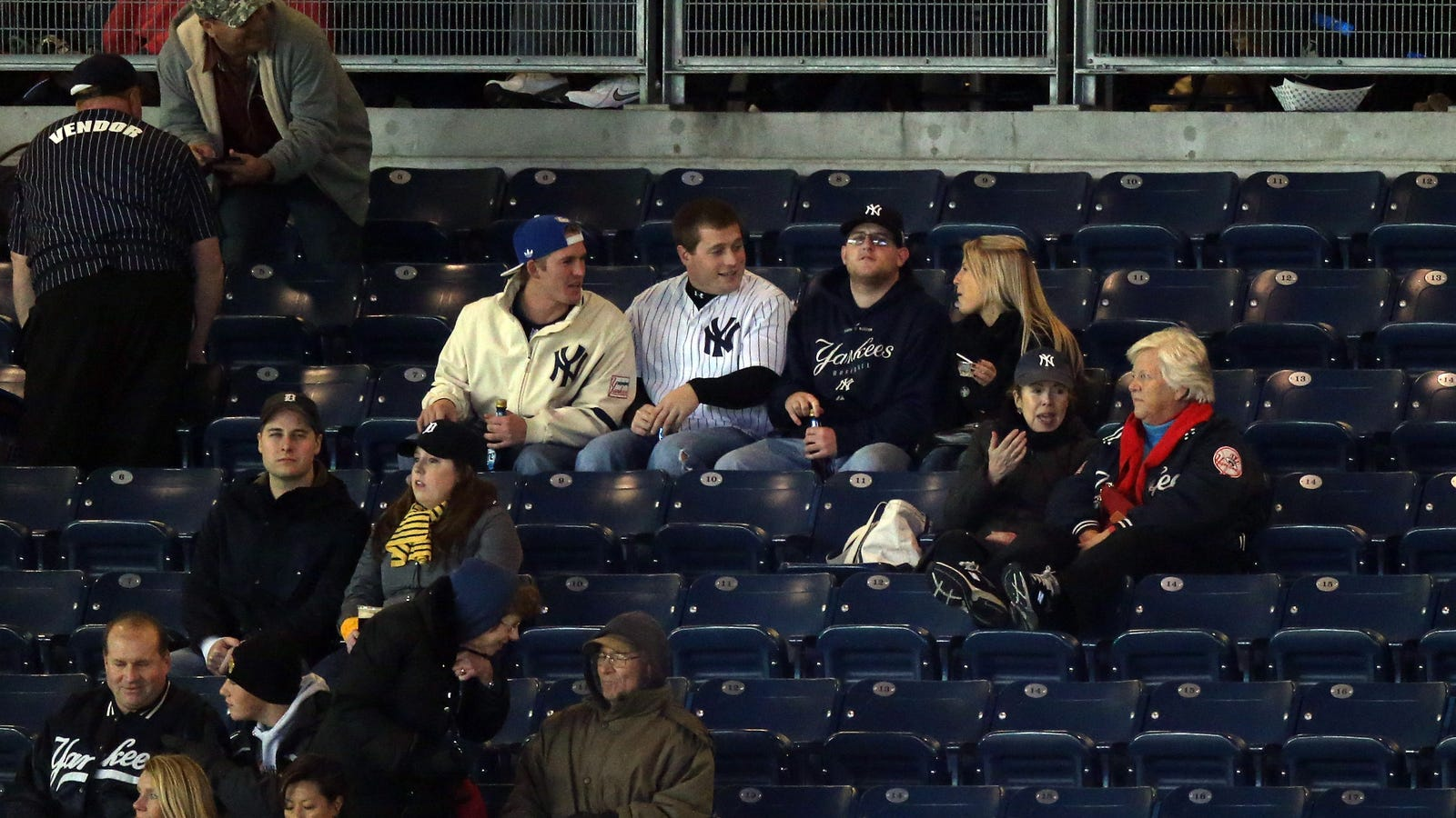 Fans taking pictures with cell phone behind barrier stock photo - Yankees Will No Longer Accept Print At Home Tickets Thus Screwing Their Fans