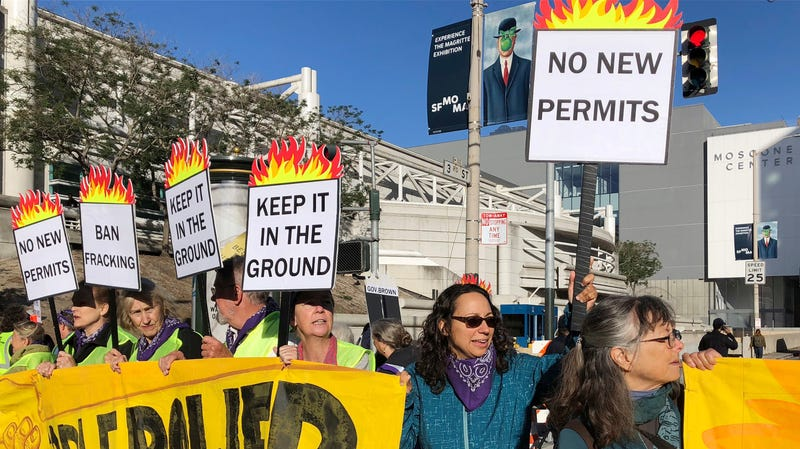 Activists call for a moratorium on fracking outside a climate summit in San Francisco.