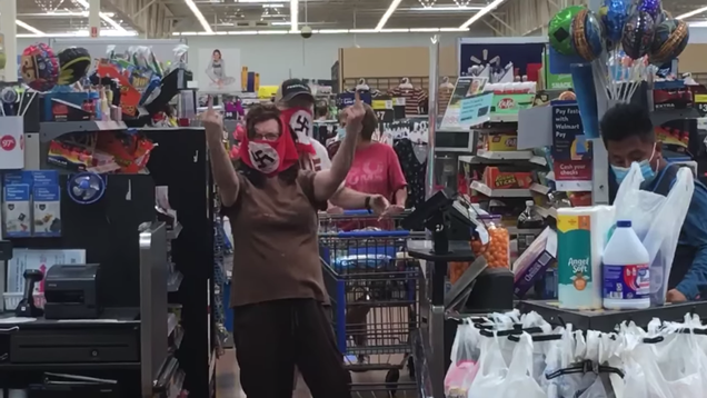 Couple Who Wore Face Masks Bearing the Nazi Flag Swears They Aren t Nazis
