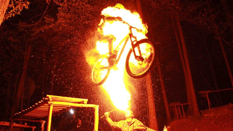 Illustration for article titled Bike Jumping While Someone Spits Fire On You Looks Really Fun