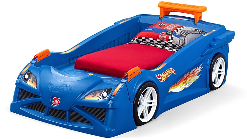 this race car bed is a giant extension of your kids hot wheels tracks