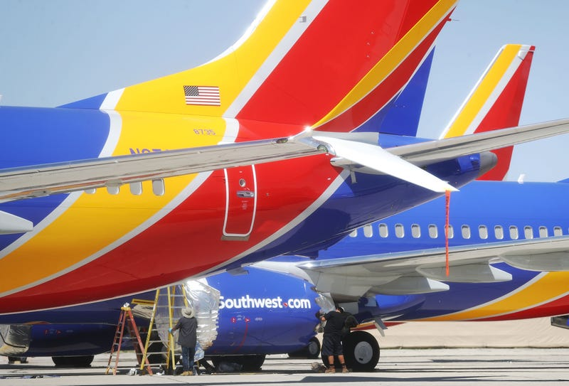 "Workers stand under Southwest Airlines Boeing 737 MAX aircraft parked at Southern California Logistics Airport March 27, 201<div class=""e3lan e3lan-in-post1""><script async src=""//pagead2.googlesyndication.com/pagead/js/adsbygoogle.js""></script>