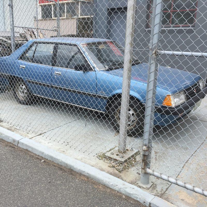 GJ Mitsubishi GL sedan 2.6L auto