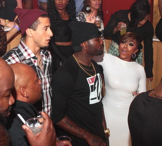Colin Kaepernick, Michael Vick and Kijafa Vick in 2013 in Atlanta (Prince Williams/FilmMagic)