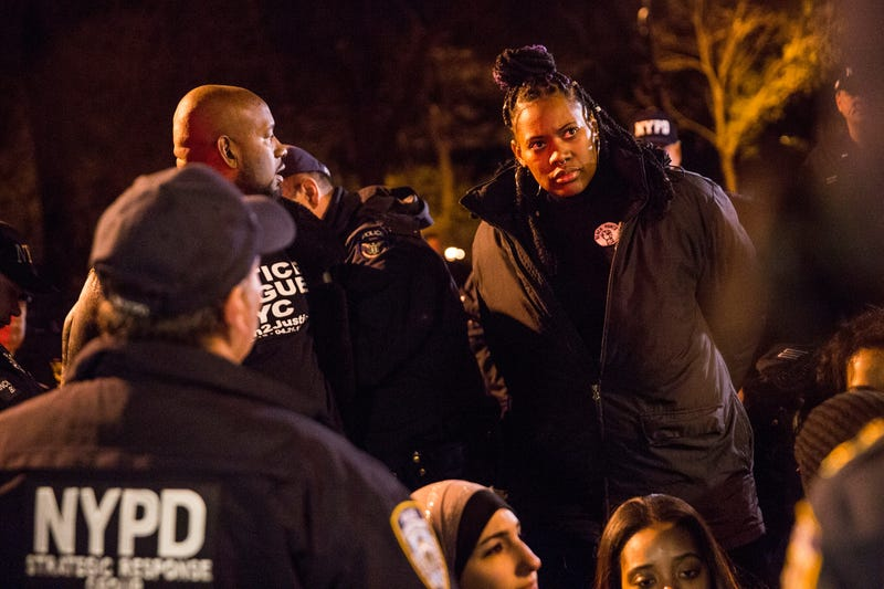 A protester is arrested on Dec. 3, 2015, for blocking traffic outside Gracie Mansion, the traditional home of New York City mayors, while calling for further action against Daniel Pantaleo, the New York Police Officer who used a New York Police Department-banned choke hold and killed Eric Garner while detaining him in 2014.