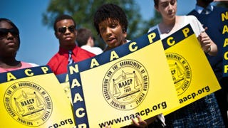 Members of the NAACP in front of the U.S. Supreme Court in Washington, D.C., on June 25, 2013NICHOLAS KAMM/AFP/Getty Images