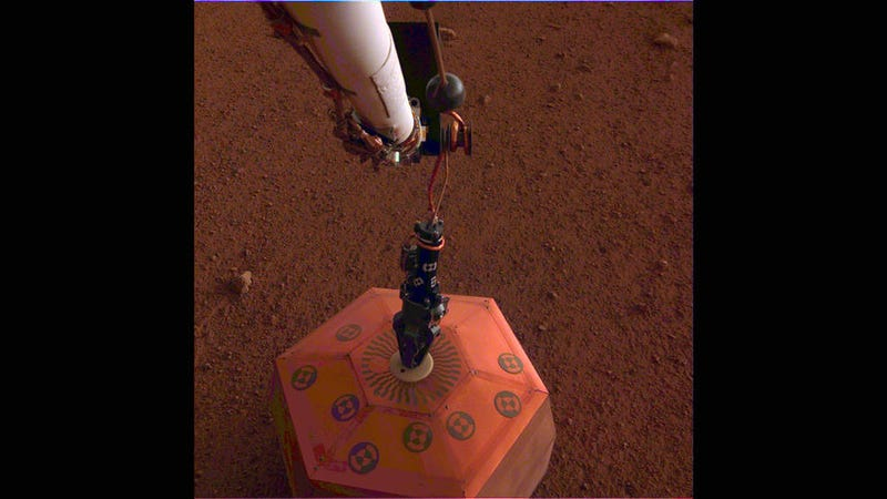 InSight placing the seismometer on the Martian surface.