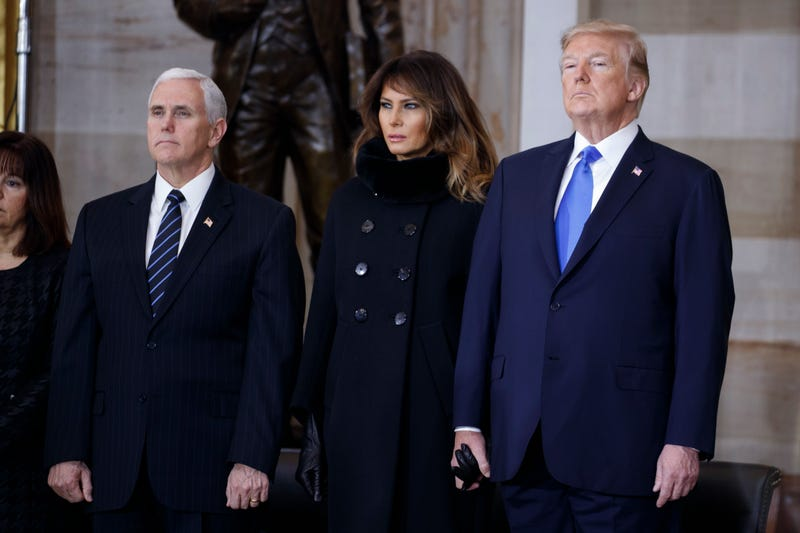 Vice President Mike Pence with a hand-holding first lady Melania Trump and President Donald Trump at ceremonies for the late evangelist Billy Graham at the U.S. Capitol, on Feb. 28, 2018, in Washington, D.C.