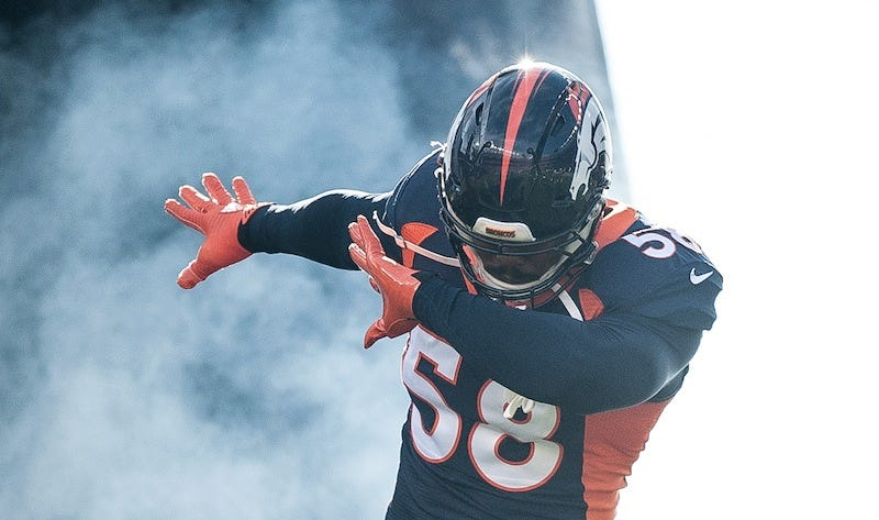 Illustration for article titled Von Miller Shows Off Ball He Intercepted, Jokes About It Being Deflated