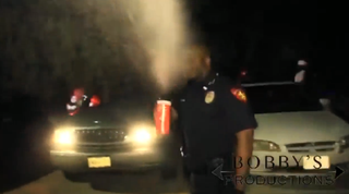 Officer Adolphus Cannon using pepper spray on Oct. 6, 2014KTRK/Bobby Productions