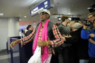 Former NBA player Dennis Rodman prepares to check in for his flight to North Korea at Beijing's international airport.WANG ZHAO/AFP/Getty Images