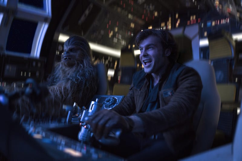 Chewbacca and Han Solo (Alden Ehrenreich) get settled in their new ship, the Millennium Falcon.