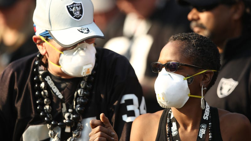Raiders fan wearing breathing masks during last week's game against the Chargers.