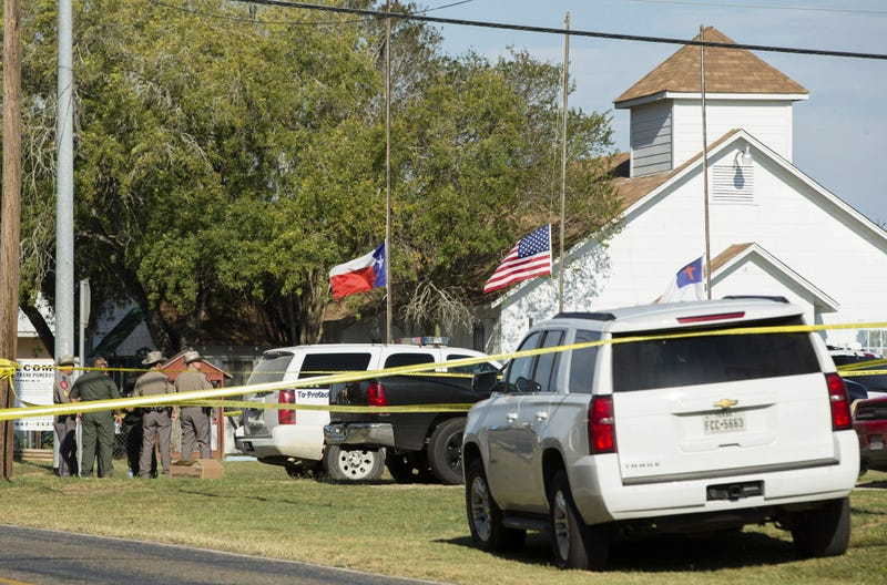 Law-enforcement officials gather near the First Baptist Church in Sutherland Springs, Texas, following a mass shooting there Nov. 5, 2017.  (Erich Schlegel/Getty Images)