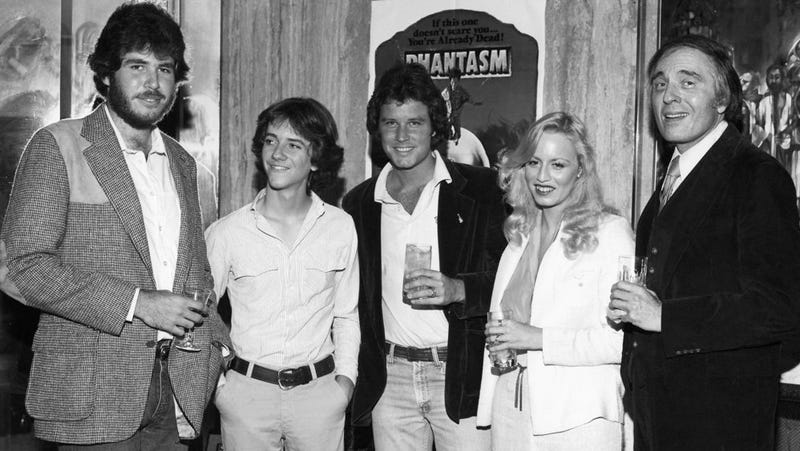 Don Coscarelli (far left) and the cast of 1979's Phantasm toasting the movie's success.