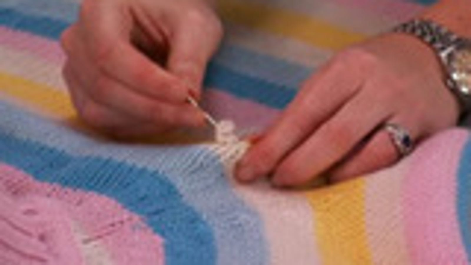 Mend A Sweater Snag With Nail Polish