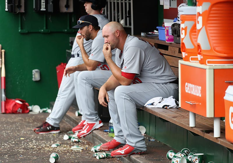 Pitcher Jonathan Broxton sits in the dugout after being pulled in the seventh inning of another Cardinals loss. Via Getty.