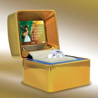Illustration for article titled Gold Wedding Ring Box Has 2-inch LCD, Plays Video