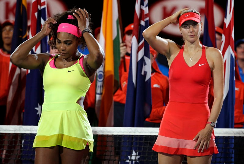 Serena Williams and Maria Sharapova wait for the trophy presentation after the women's singles final at the Australian Open tennis championship in Melbourne on Jan. 31, 2015.