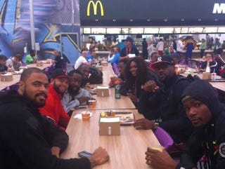 Illustration for article titled Andre Iguodala Too Busy Eating At McDonald's To Pose For Photo With Serena Williams And Other USA Basketball Players