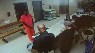 In the wake of her arrest after a July 2015 traffic stop, Sandra Bland is seen in a video screenshot standing before a desk at the Waller County Jail in Hempstead, Texas. Bland was found dead in her cell days after her arrest.Twitter