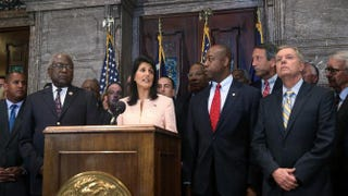 South Carolina Gov. Nikki Haley, flanked by Rep. James Clyburn (D-S.C.) and Sens. Tim Scott and Lindsey Graham (R-S.C.), delivers a statement to the media asking that the Confederate flag be removed from the Statehouse grounds on June 22, 2015, in Columbia, S.C.Joe Raedle/Getty Images
