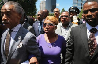 Lesley McSpadden (center), the mother of slain teenager Michael Brown, arrives for a press conference with the Rev. Al Sharpton (left) Aug. 12, 2014, in St. Louis. Scott Olson/Getty Images