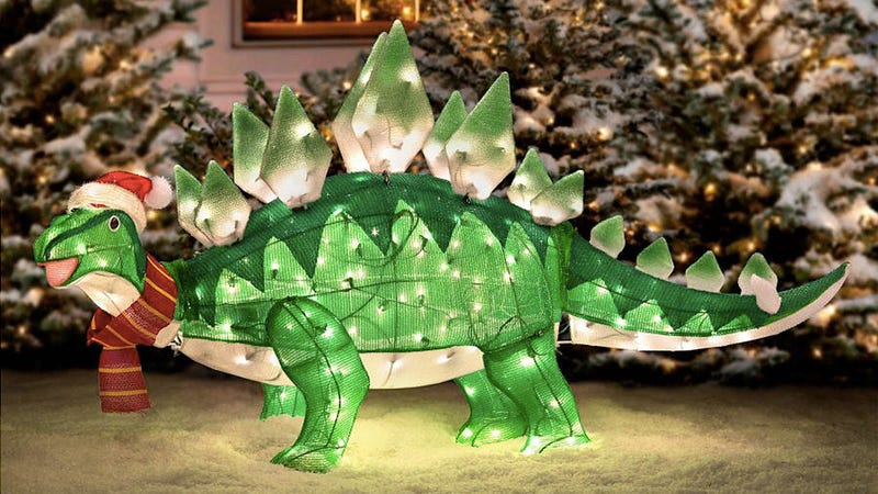 a lightup stegosaurus is just what your lawn nativity scene needed - Inflatable Christmas Lawn Decorations