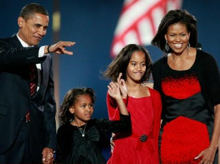 President-elect Barack Obama—along with his wife, Michelle, and daughters, Sasha (second from left) and Malia—acknowledges his supportersduring an election night gathering in Grant Park in Chicago Nov. 4, 2008.Scott Olson/Getty Images