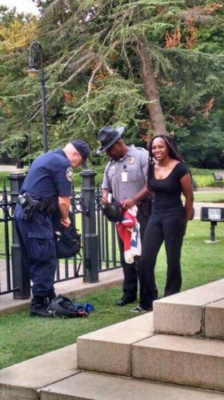 Bree Newsome being apprehended June 27, 2015, after removing the Confederate flag from the grounds of the South Carolina StatehouseTwitter