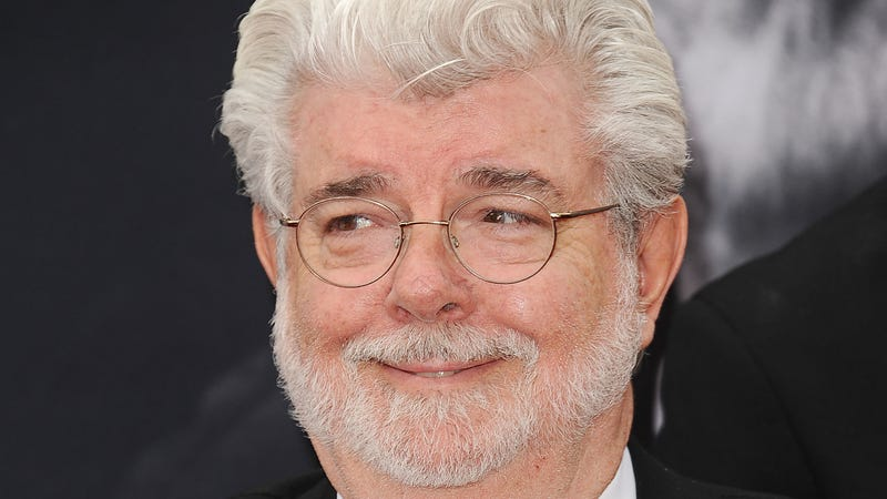 Illustration for article titled Fine, have a picture of George Lucas gently cradling Baby Yoda in his arms