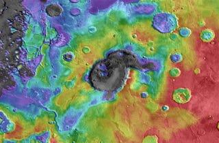 "Illustration for article titled Ancient ""supervolcanoes"" lurk on Mars"