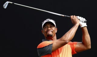 Tiger Woods tees a shot during the third round of the 2014 Omega Dubai Desert Classic Feb. 1, 2014, in Dubai.KARIM SAHIB/AFP/Getty Images