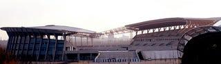 Illustration for article titled Moebius Strip Soccer Stadium Takes Shape in Shenyang