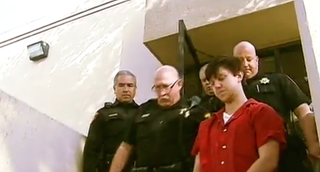 Ethan Couch is escorted by law-enforcement officials.CBS News