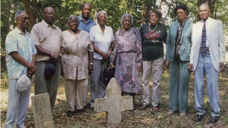 Relatives of Matthew Palmer visiting his grave site in Old Orchard Cemetery at Camp Peary, Va., formerly the town of Magruder, 1998. Edward Palmer, the writer's father, is second from the left.Department of Defense
