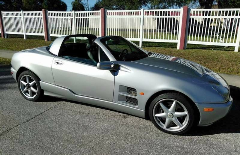 Illustration for article titled For $19,990, Could This 2001 Qvale Mangusta Have You Saying Snakes Alive?