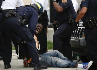 Baltimore police arrest a man near Mowdamin Mall in Baltimore April 27, 2015.Drew Angerer/Getty Images