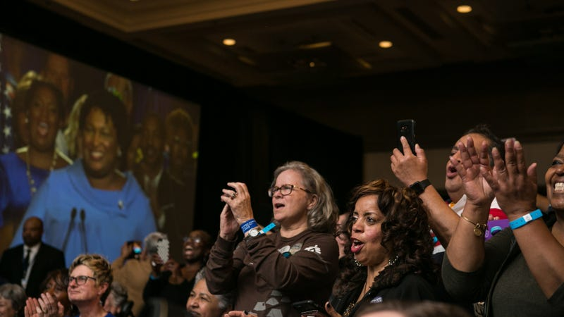Supporters cheer for Democratic Gubernatorial candidate Stacey Abrams as se addresses the crowd at an election watch party on November 6, 2018 in Atlanta, Georgia. Abrams and her opponent, Republican Brian Kemp, are in a tight race that is too close to call. A runoff for Georgia's governor is likely.