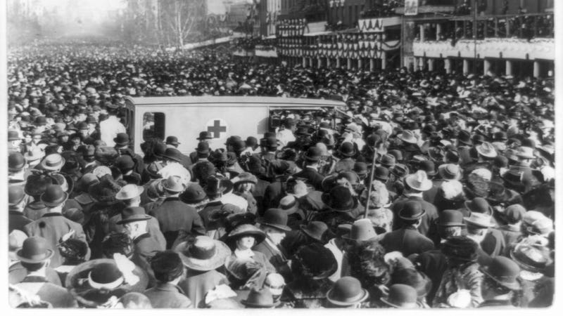 A crowd gathers around a Red Cross ambulance during the women's suffrage procession in Washington, 1913. Library of Congress via AP Images.